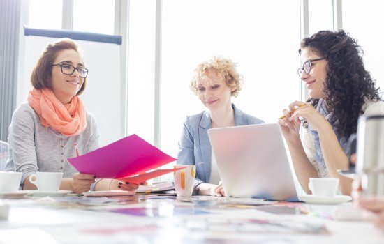 Businesswomen working at desk in creative office